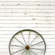 Antique Wooden Wagon Wheel on Rustic White Background — Stock Photo
