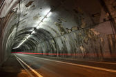 Night view of a lighted road tunnel — Stock Photo