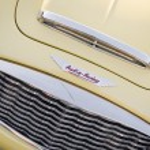 Постер, плакат: Detail of yellow classic car