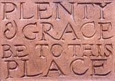 Escrito en una placa de pared de terracota — Foto de Stock