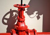 Close up of red stop valve and pipeline — Stock Photo