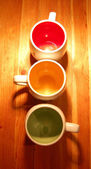 Colored mugs — Stock Photo