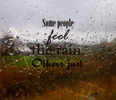 "Vector background with the quote ""Some people feel the rain, others just get wet"". — Stock Vector"