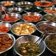 Bowls of kimchi on a Korean traditonal food market — Stock Photo