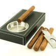 Cigar ashtray, cigar cutter and cigars — Stock Photo #25146989
