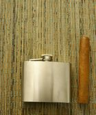 Cigar and hip flask — Stock Photo
