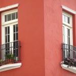 Постер, плакат: White windows Red stucco building