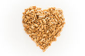 Peanuts heart shape on white isolated — Stock Photo
