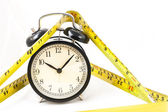 Tape measure tape measure with clock in isolated — Stock Photo