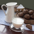 Stock Photo: Glass cup of milk on an old table, still life