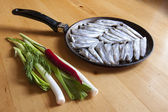 Fresh fish on an old frying pan — Stock Photo