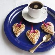 Stock Photo: Three cookies in the shape of heart on the blue plate