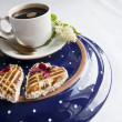 Two cookies in the shape of heart on the blue plate — Stock Photo