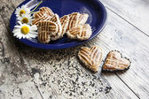 Cookies in the shape of heart on the blue plate — Stock Photo