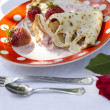 Pancakes with strawberries and sour cream three daisies — Stock Photo