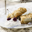 Stock Photo: Crumbly cake with cherries and whipped whites