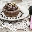 Diet chocolate cupcakes on white plate with pink spoon — Stock Photo