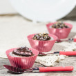 Stock Photo: Diet chocolate cupcakes and three spoons. Vertical format