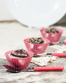 Diet chocolate cupcakes and three spoons. Vertical format — Stock Photo