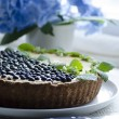 Stock Photo: Blueberry pie with mint and beautiful flower