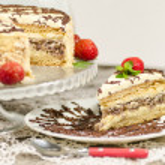 Постер, плакат: Homemade nutty cake with strawberries and slice of cake