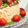 Stock Photo: Homemade nutty cake with strawberries. Macro, vertical