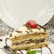 Stock Photo: Slice of homemade nutty cake with strawberries and mint. Vertical format