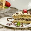 Stock Photo: Slice of homemade nutty cake with strawberries and mint. Blurred background