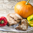 Bread, pumpkin and pepper on old wooden table — Stock Photo