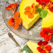Pumpkin cheesecake decorated with fresh flowers. Vertical format — Stock Photo
