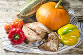 Bread and vegetables on old wooden table — Stock Photo
