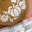 Pumpkin cake on glass plate and kitchen towel — Stock Photo
