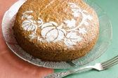 Pumpkin cake on glass plate — Stock Photo