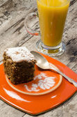 Pumpkin cake on plate and juice — Stock Photo