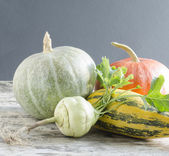 Fresh vegetables on old wooden table — Stock Photo