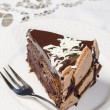 Stock Photo: Slice of chocolate cake decorated with white chocolate flakes