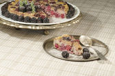 Slice of Blackberry Clafoutis on metal plate with fresh berries — Stock Photo