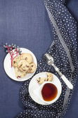 Porcelain dishes and cookies with cranberries — Stock Photo