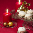 Christmas decoration with candles ribbons and cookies — Stock Photo
