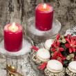 Christmas decoration with candles ribbons and cookies — Stock Photo #35654225