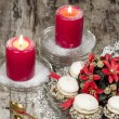 Christmas decoration with candles ribbons and cookies, blurred background — Stock Photo