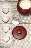 Homemade cookies Valentine's Day and cup of milk — Stock Photo