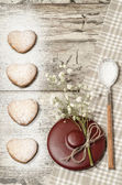 Homemade cookies Valentine's Day background for greeting card with beautiful flower and tableware — Stock Photo