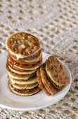 Caramel Florentines cookies on a wooden cutting board — Stock Photo
