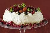 Meringue Cake Pavlova with cream, berries  and mint — Stock Photo
