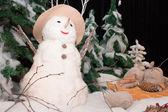 Snow man with a Christmas-tree. — Stock Photo