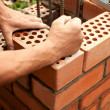 Stock Photo: Working in progress. Bricks laying