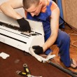 Air conditioning master preparing to install new air conditioner — Stock Photo #24967029