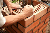 Working in progress. Bricks laying — Stock Photo