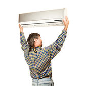 Air conditioner installer — Stock Photo